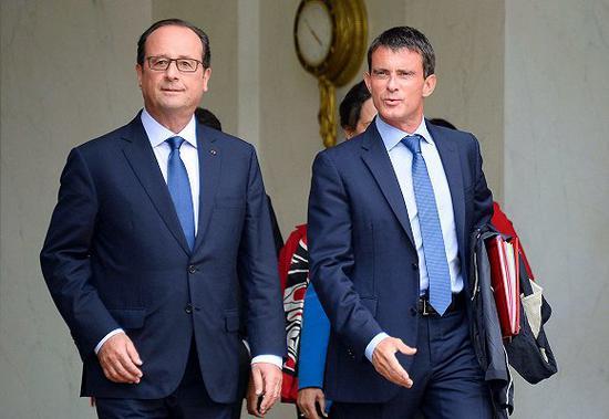 资料图:2014年,时任法国总统奥朗德与法国总理瓦尔斯 来源:视觉中国