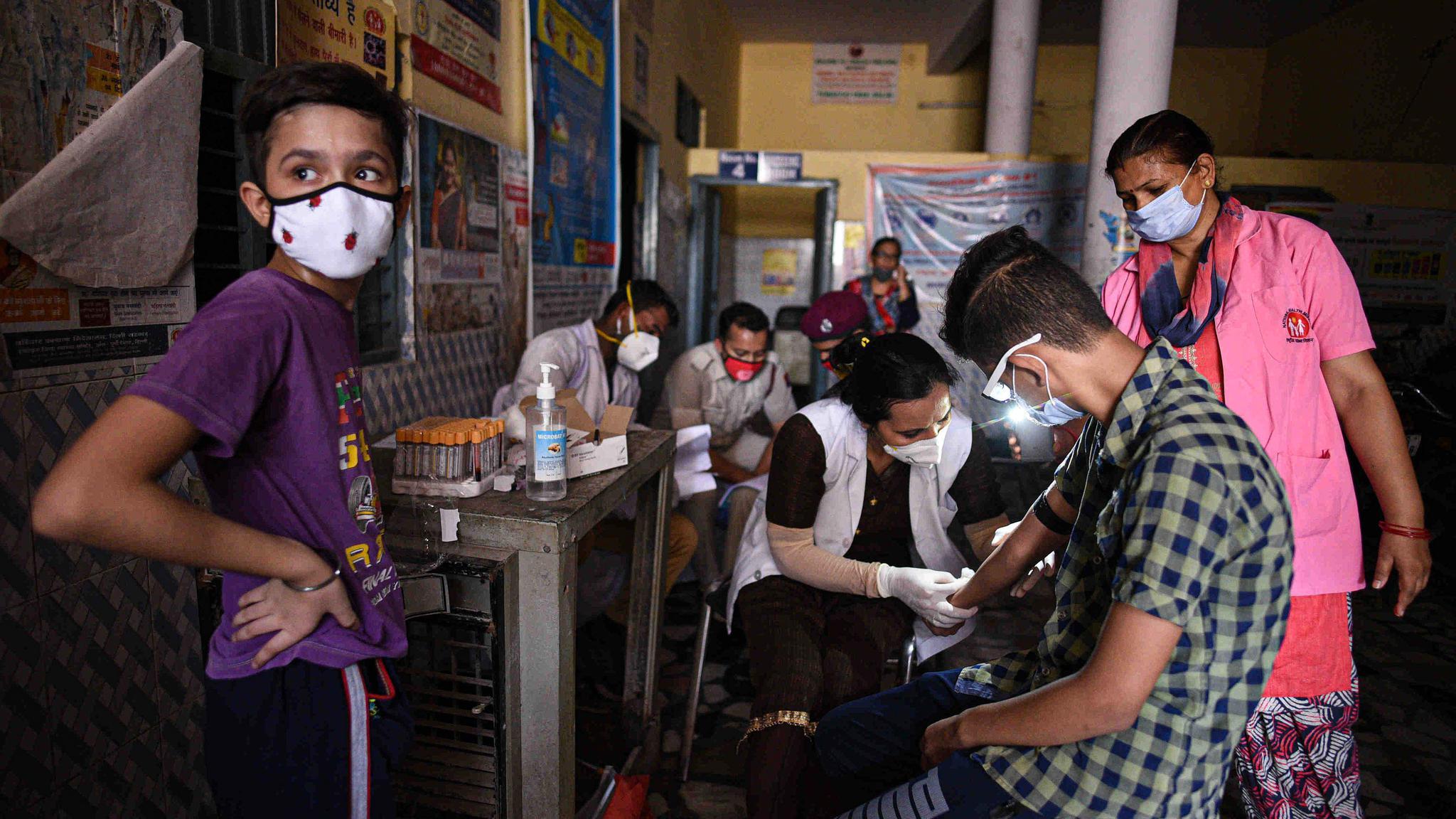 单日新增确诊病例近10万的印度 为何仍坚持重启经济