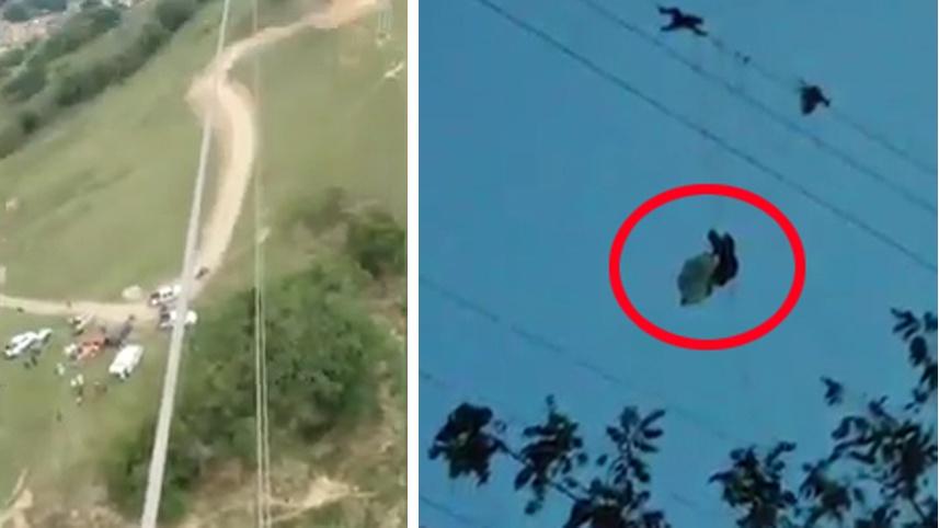 外国男子玩滑翔伞被高压线缠住 悬挂150米高空(图)