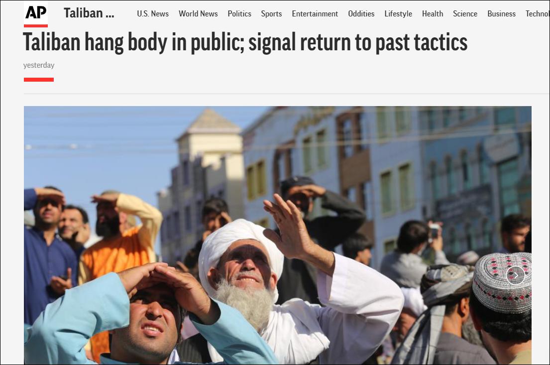 击毙绑匪后,阿富汗塔利班在广场将尸体吊起示众