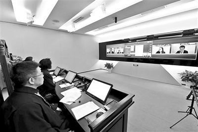 北京互聯網法院首案開庭 原被告視頻連線參